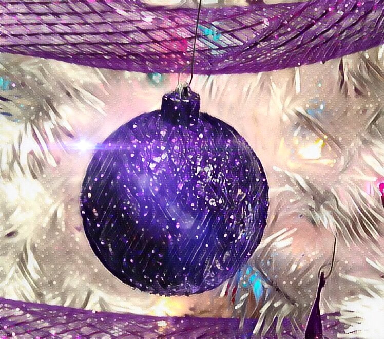 Picture: Image of a glass globe, purple Christmas ornament with glitter.