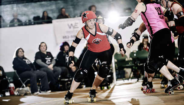 Roller Skating women in action during a North Star Roller Derby bout.