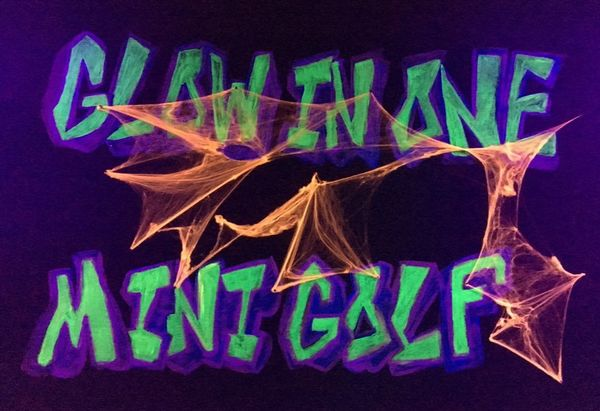 Picture: Glow in One Mini Golf sign with Halloween cobwebs